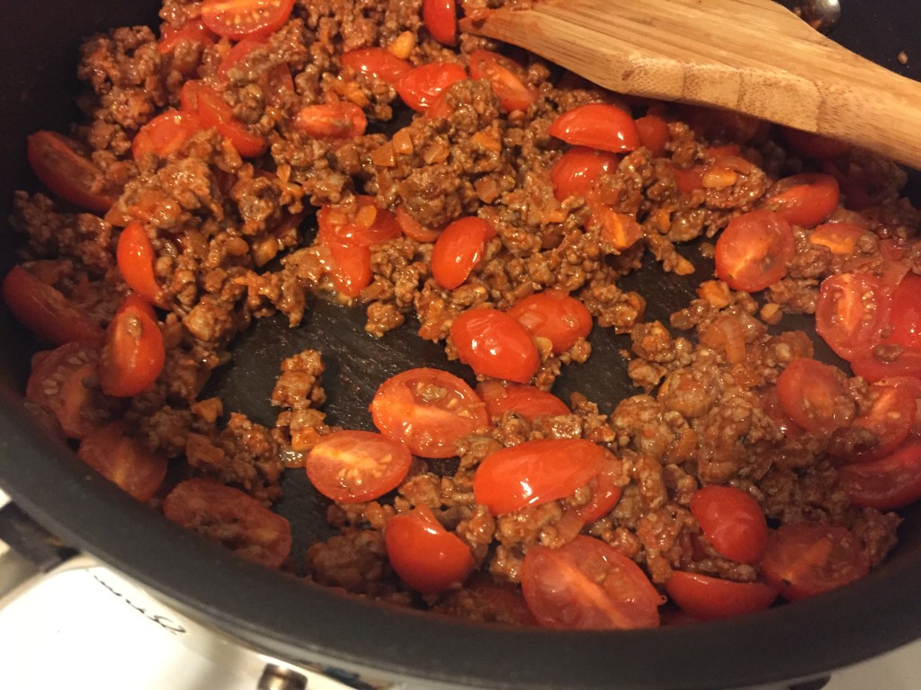 Mixture of lamb, tomatoes, and spices, before adding the wine